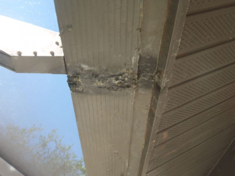 Corrosion on a pool cage frame