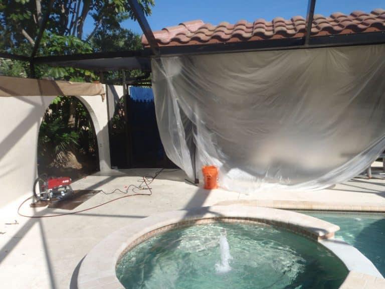 Pressure washing a pool deck