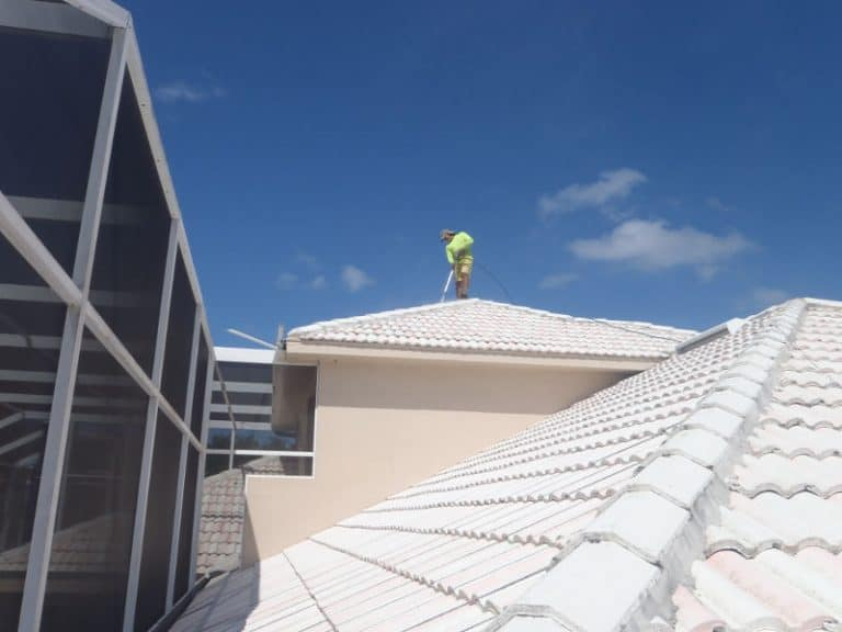 Pressure washing a tile roof