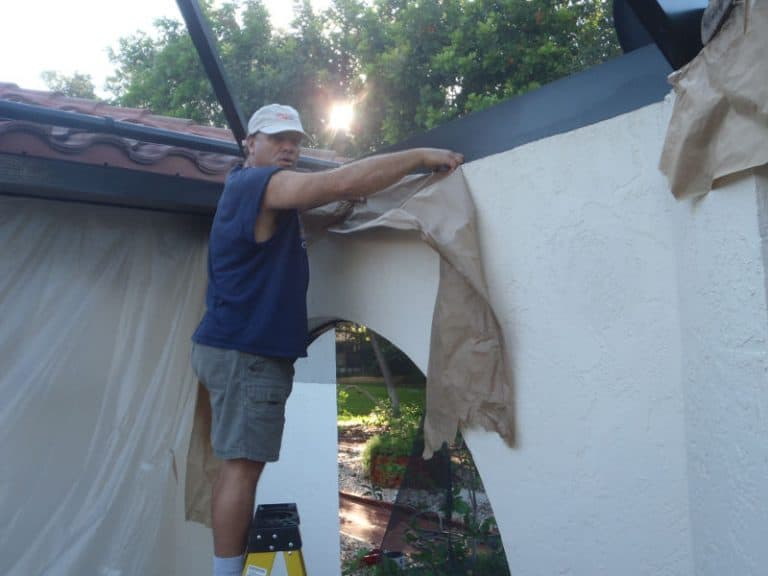 Mark Shannahan taping off a pool cage paint job