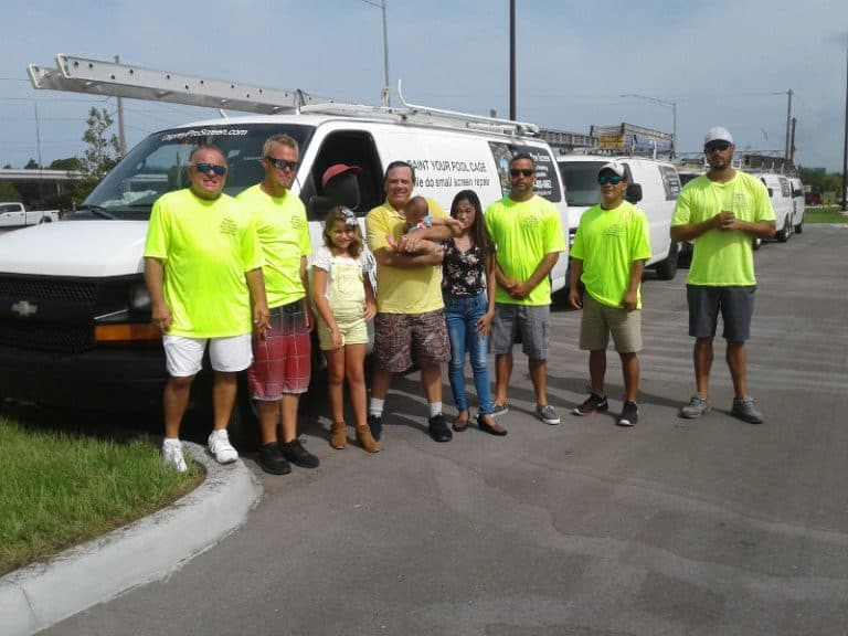 The crew of Osprey Pro Screen in front of a company van
